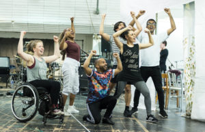 Members of the Tommy cast enjoying rehearsals.