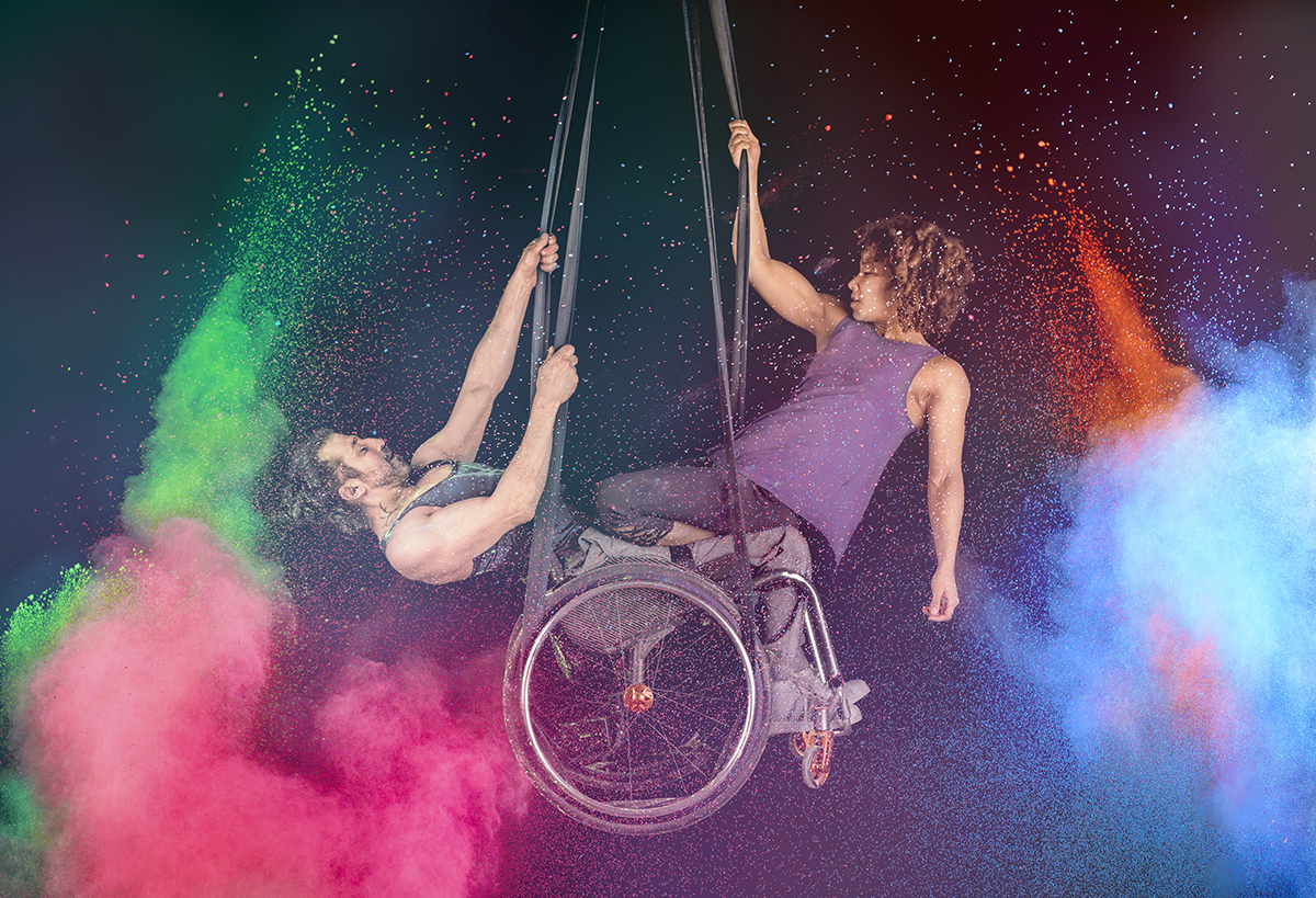 Hanging acrobats in wheelchairs